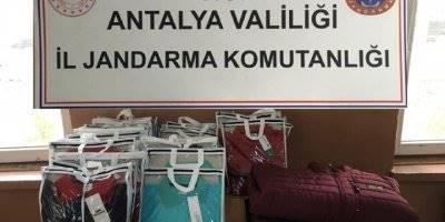 Antalya Korkuteli'nde Kaçak İçki Ve Eşofman Ele Geçirildi